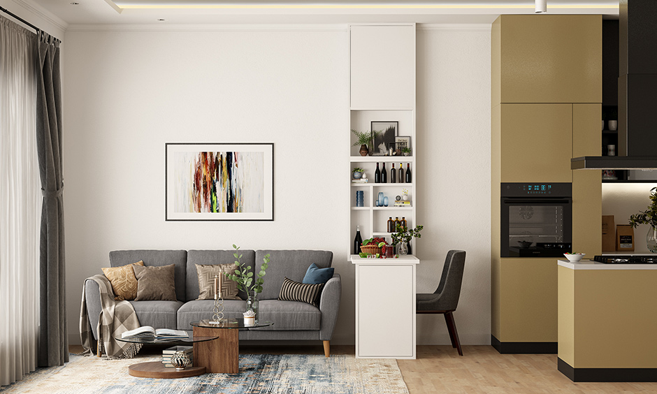 1bhk flat interior living room with drop-down breakfast table & flushing into the wall when not needed is space-saving ideas.