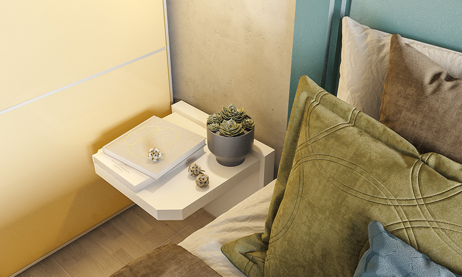 This bedroom has a compact drop down side table mounted on the wall & can be lifted up is small 1bhk interior design ideas.