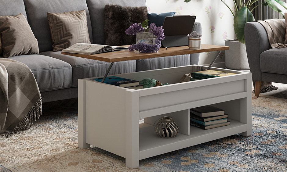 Home interior design for 1bhk flat, the coffee table can be used as a laptop desk & the hidden space to store books.