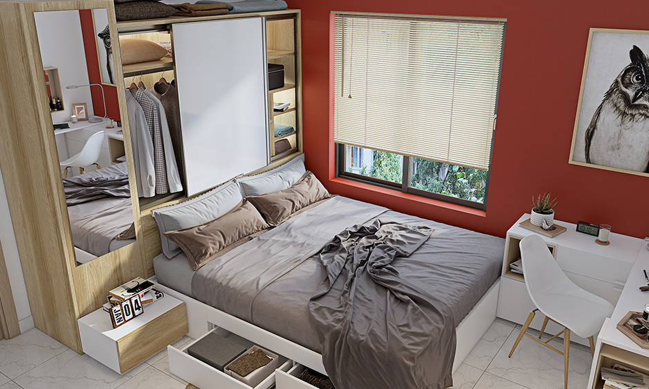 Bed with a headboard cum mini sliding door wardrobe in a pure white laminate for space-saving home interior for 1bhk flat.