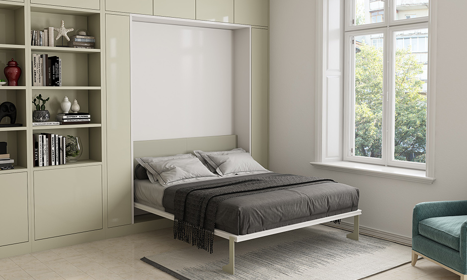 This white bedroom has a murphy bed for saving some floor space is the best interior design for 1bhk flat.