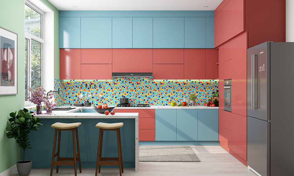 Bold g shaped kitchen layout with colourful backsplash with LED strip lighting with overhead cabinets