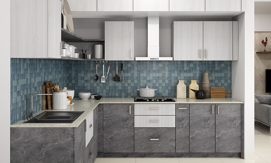Kitchen setup for small house with blue mosaics backsplash, open shelves, cabinets & white granite countertop look elegant.