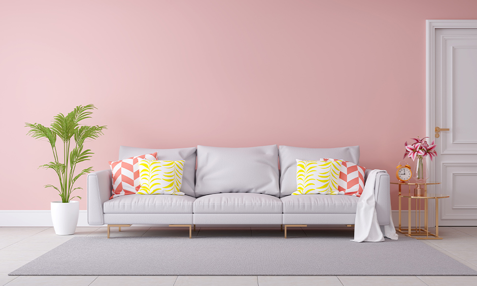 A pretty pale pink with vastu shastra colors for living room which fosters warmth according to vastu shastra
