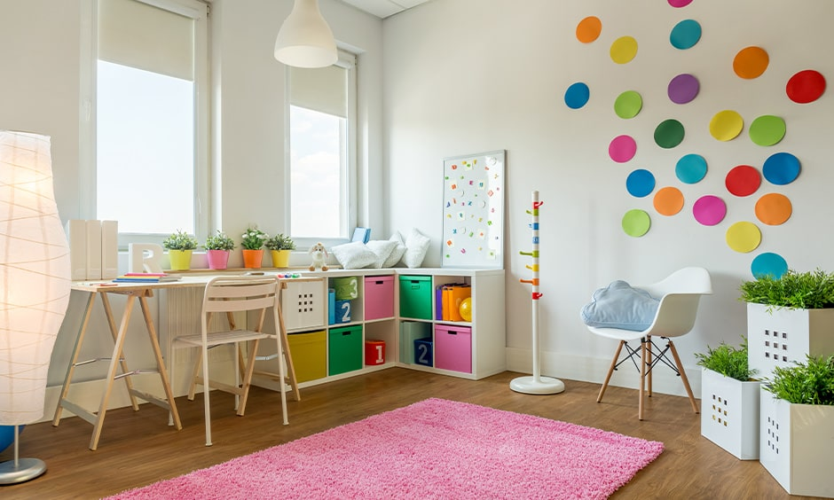 Small children room decorating ideas with a white-walled decorated with different coloured paper