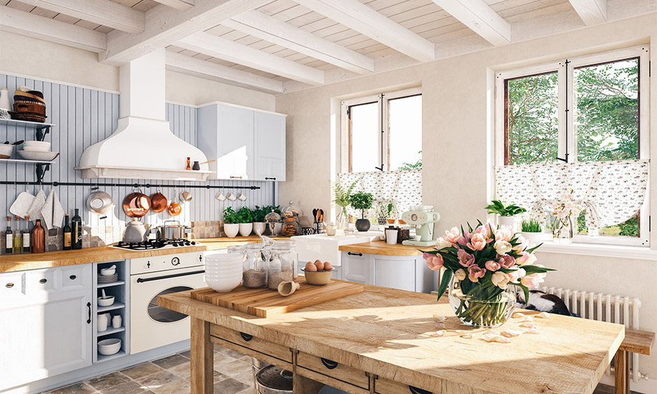 Kitchen with a dining table made from light wood and shelves for storage is country style kitchen ideas with dining table.