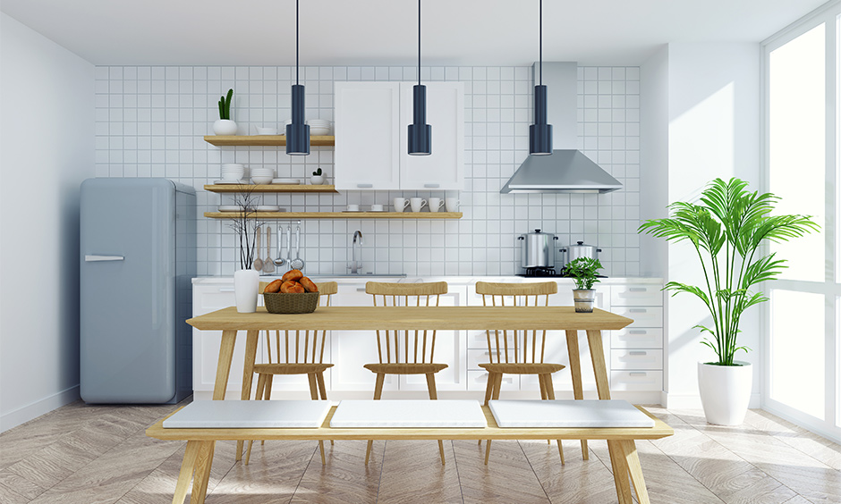 White tiles wall kitchen interior design with a dining table bench style which is sure to give you a picnic vibe.