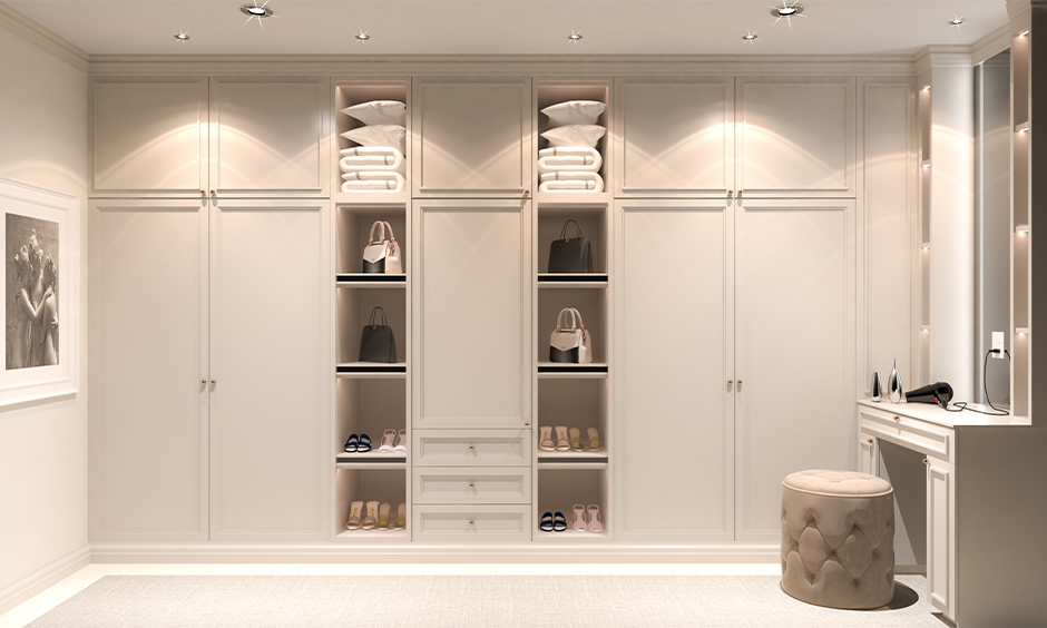 White laminated wooden wardrobe with dressing table with LED strip lighting shelves is a modern yet classic twist.