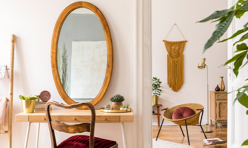 Oval mirror shaped dressing table design with wood, and matching chair with a soft velvet cushion is spectacular.