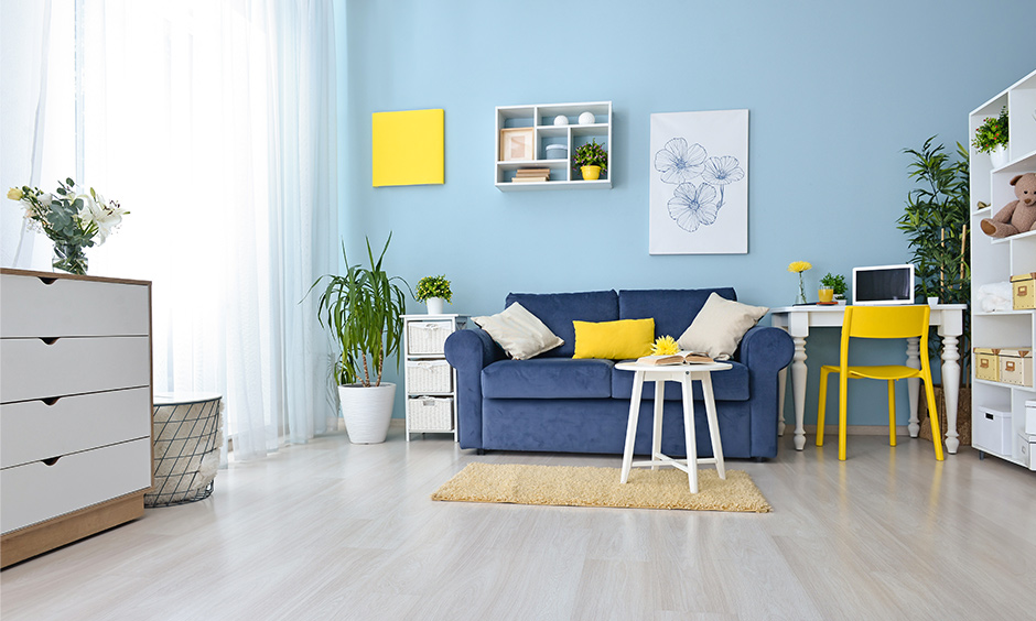 Shades of blue for living room pastel wall colors with a lot of soft whites furniture brings freshness to the place.