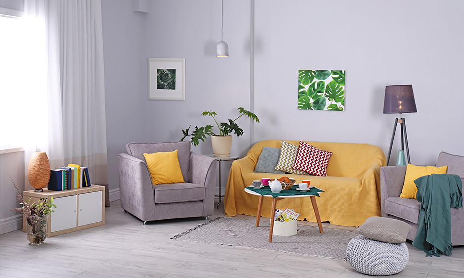 Living room in lavender pastel wall colour with grey & yellow sofa & coffee table looks stunning.