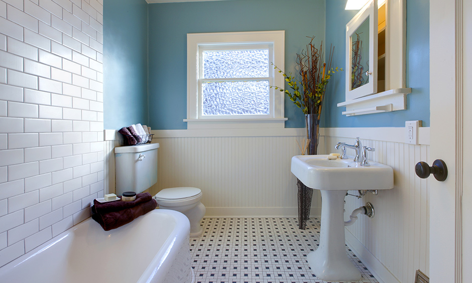 Bathroom in pastel blue wall paint colour with white tiles is refreshing and brightens up space.