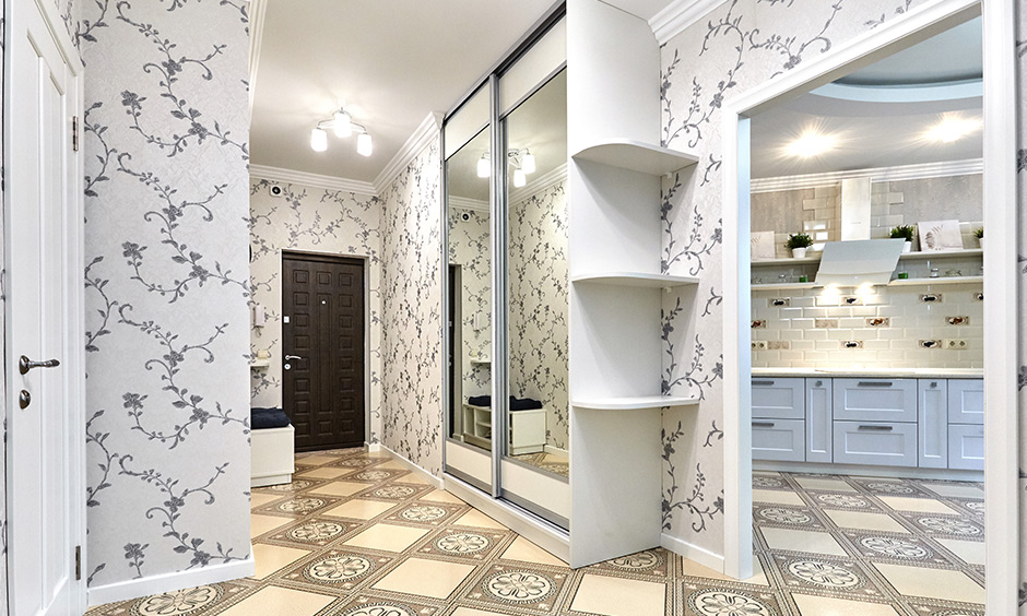 Patterned white wallpaper for hall room adds a much-needed brightness to this narrow hallway
