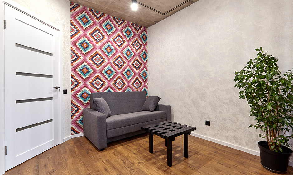 Quirky hallway wallpaper adds an exciting and fun vibe to the hallway with a sofa.