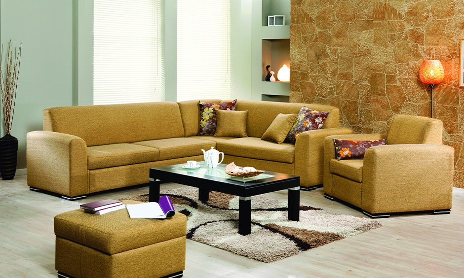 Stunning mustard toned l-shaped sofas has an additional one-seater sofa is perfect sofa design for small living room