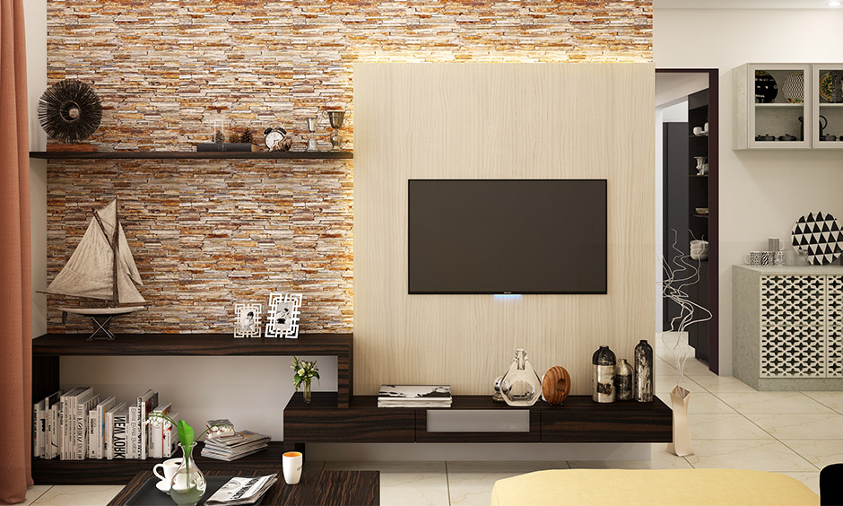 An exposed brick wall is a perfect backdrop for the TV unit & floating shelves is an accent wall ideas for small living room