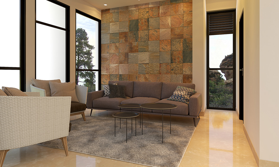 The chequered texture wall design perfectly works with the neutral colour is a living room accent wall ideas