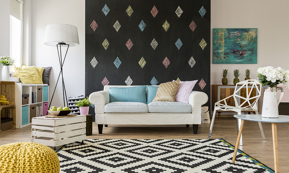 An accent wall ideas for living room, a sofa behind chalkboard accent wall is a fun design and looks vibrant