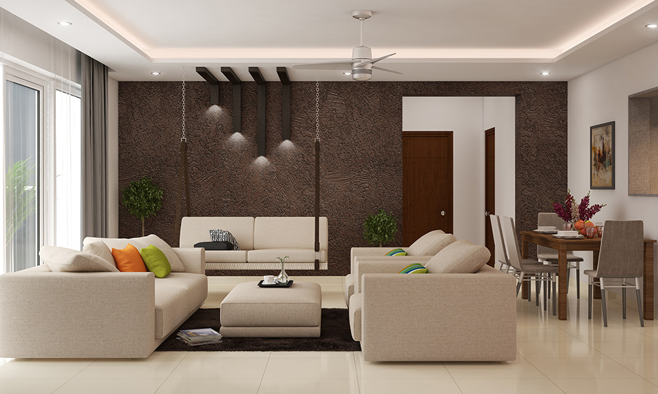 A dark living room accent wall colours are the unique feature in the interior design of this living room.