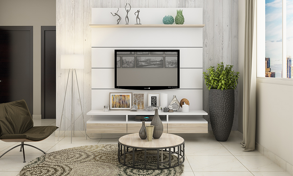 TV-unit against the wall with wooden panels adds lovely structure to the accent wall for white living room.