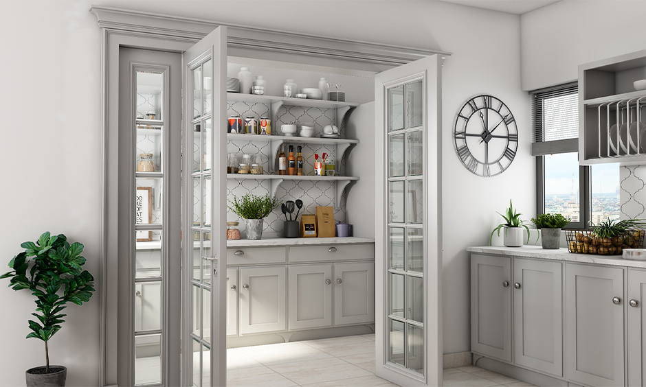 White kitchen with a three-layered wall shelf rack to store jars & containers is a beautiful kitchen wall shelf design.
