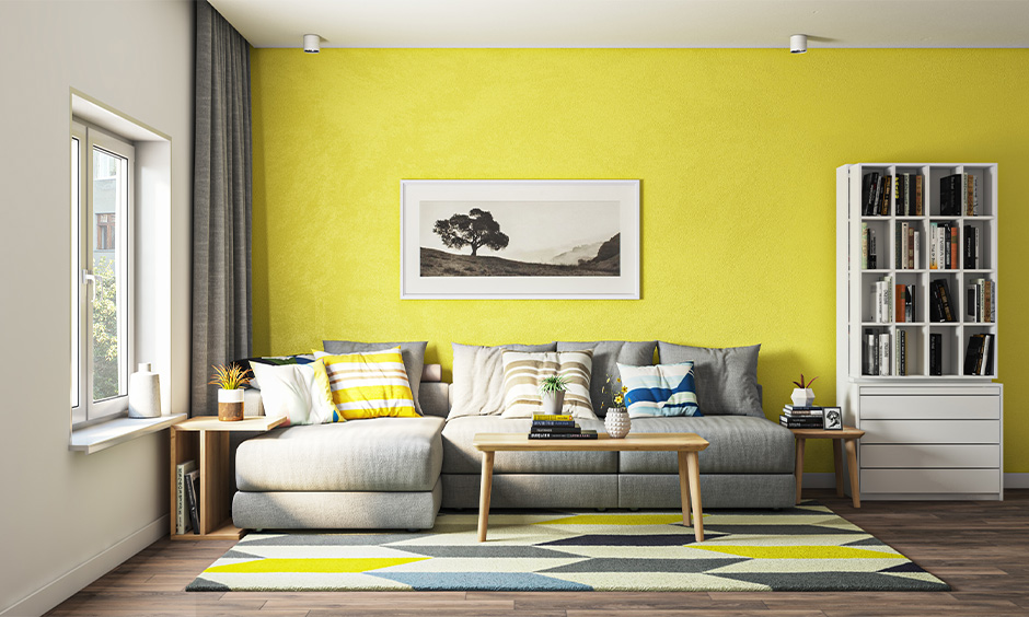 Living room l shaped sofa design is lounging seat & set up against a wall for watching television.