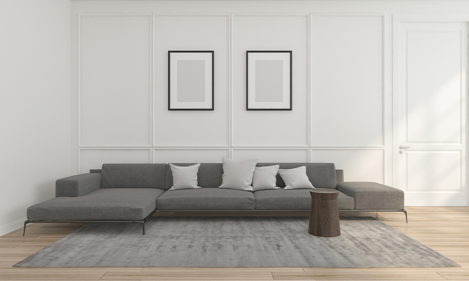 Low height living room l shape sofa set designed with extra-wide cushions look minimal and classy.