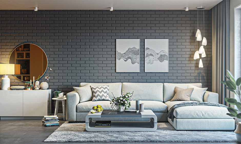Sectional grey colour l shape sofa set for living room with armrest support along the longer side is perfect to lounge.