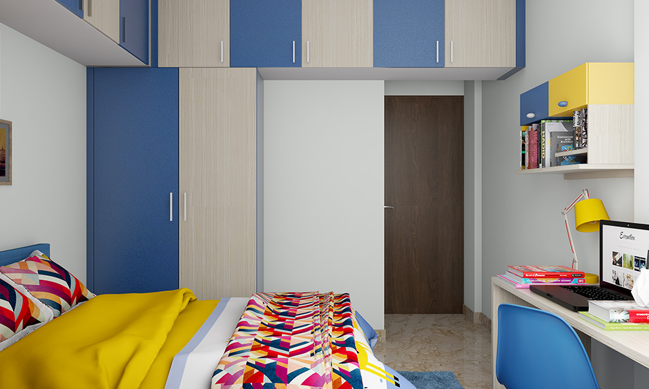 Bedroom wardrobe colours designed in half blue and the half beige combination works well.