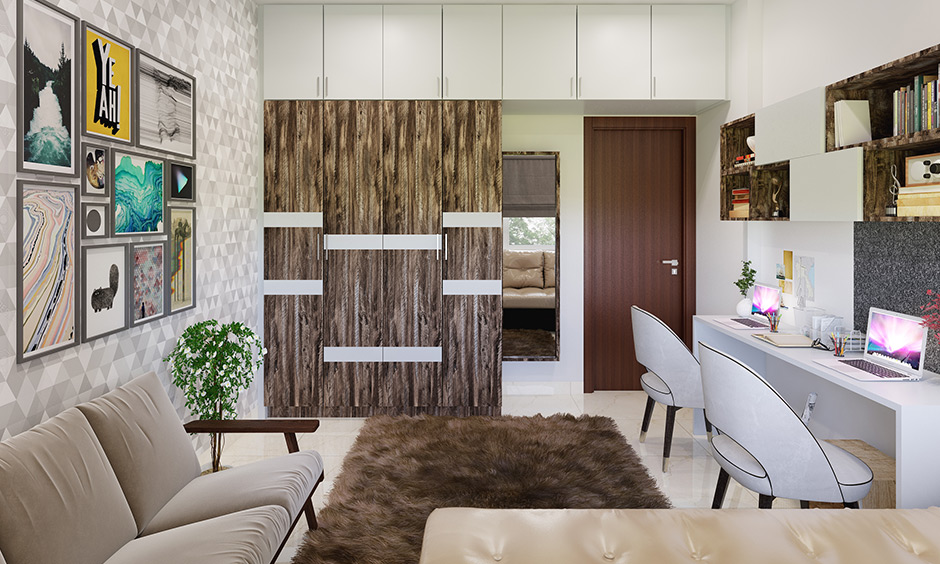 Wardrobe colour designed in natural brown finish with white highlight combination in the bedroom.