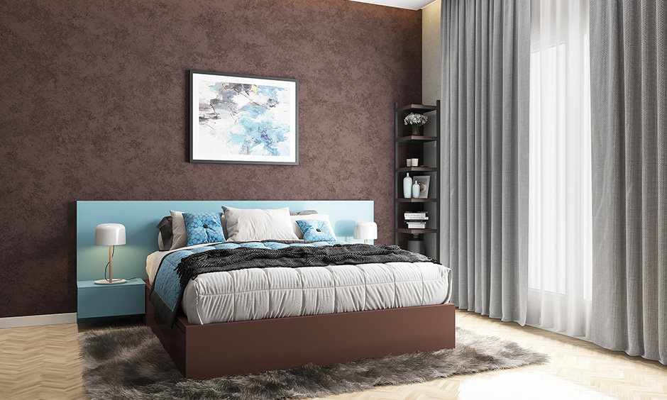 Brown and blue brown colour combination with textured paint and blue sofas