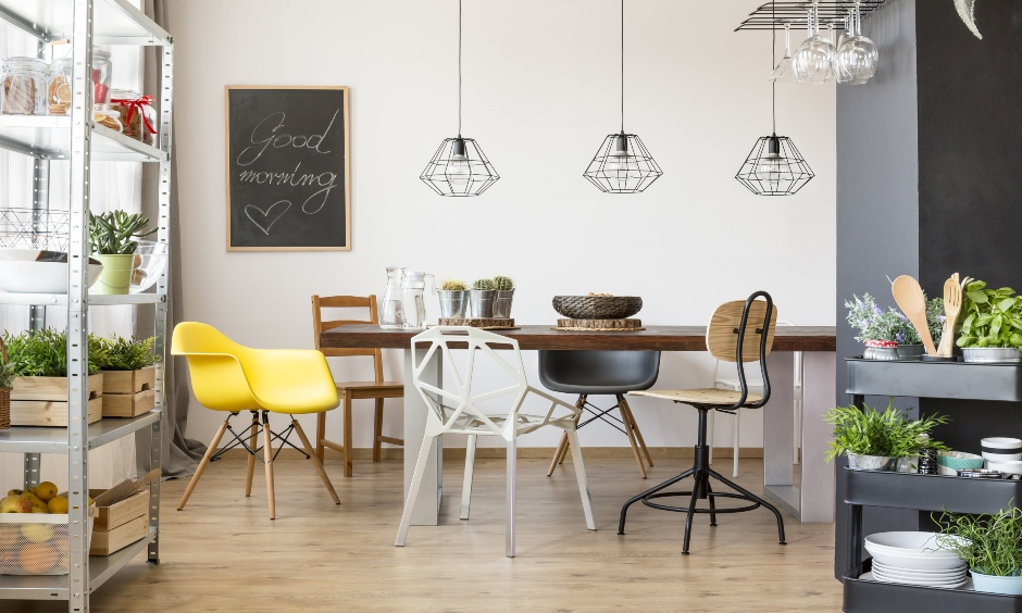 This kitchen cum dining area has two different size metal kitchen island cart