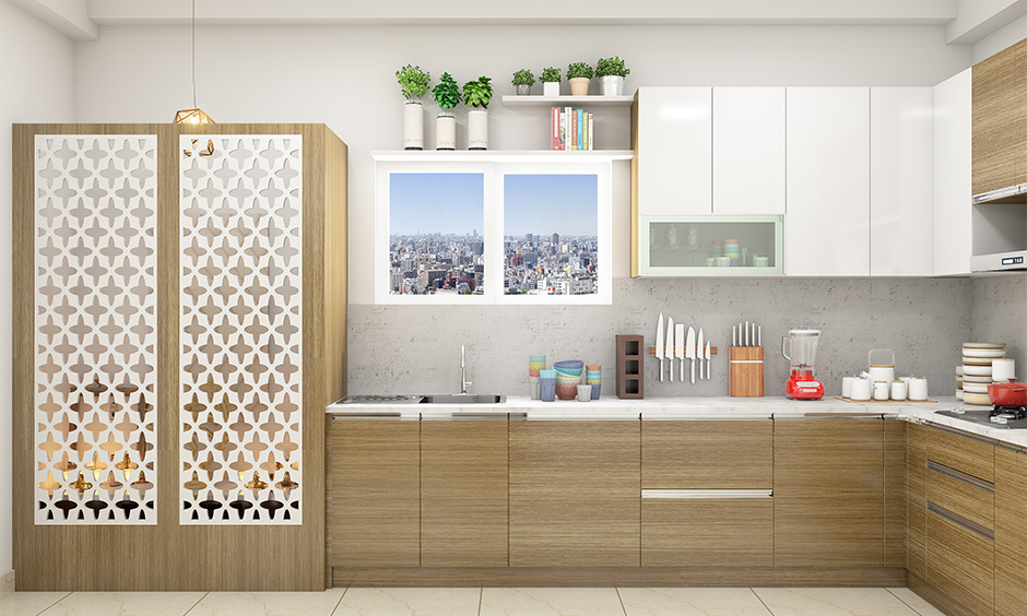 Pooja room in kitchen designs designed with criss-cross patterned doors made with wood