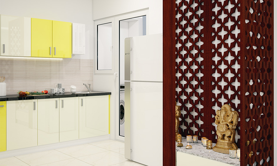 Small pooja room designs in kitchen attached to the kitchen that saves space