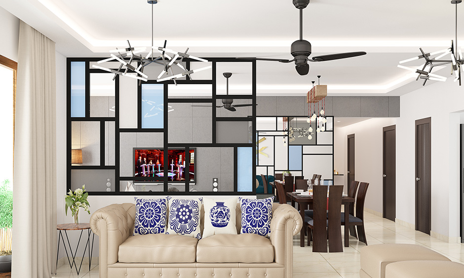 Ceiling hanging lights for the living room along with cove lighting provide a mix of both, soft lighting and style.
