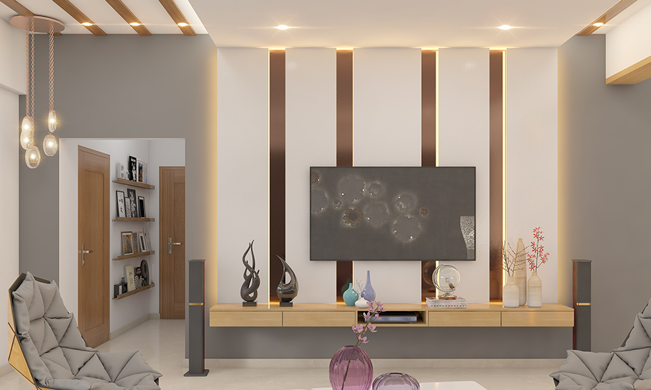 Ceiling lights design for living room embedded in the wooden panels bring in a beautiful dimension to space.