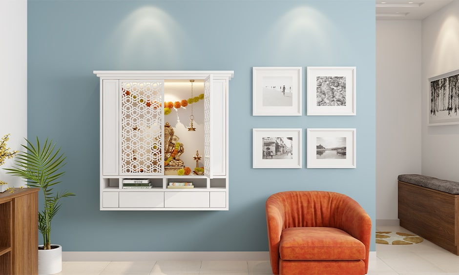 Wall mounted mandir design ideas with jali doors and bottom shelves