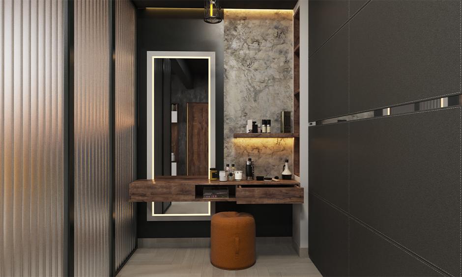 Sleek dressing table design designed with a sleek ledge for basic storage