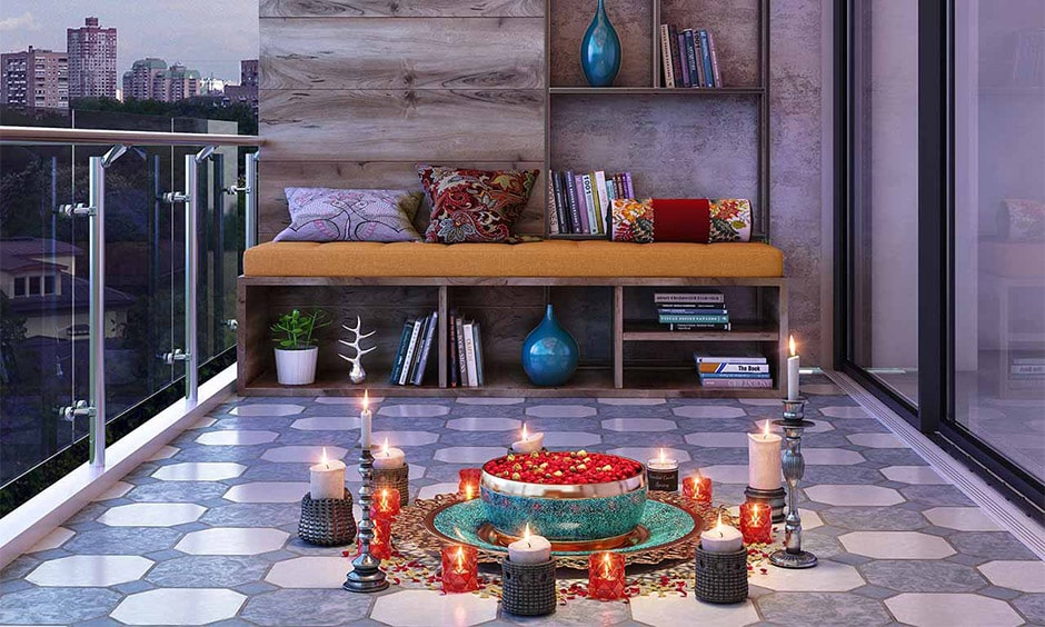 Diwali light decoration home in balcony with candles and bowl filled with petals
