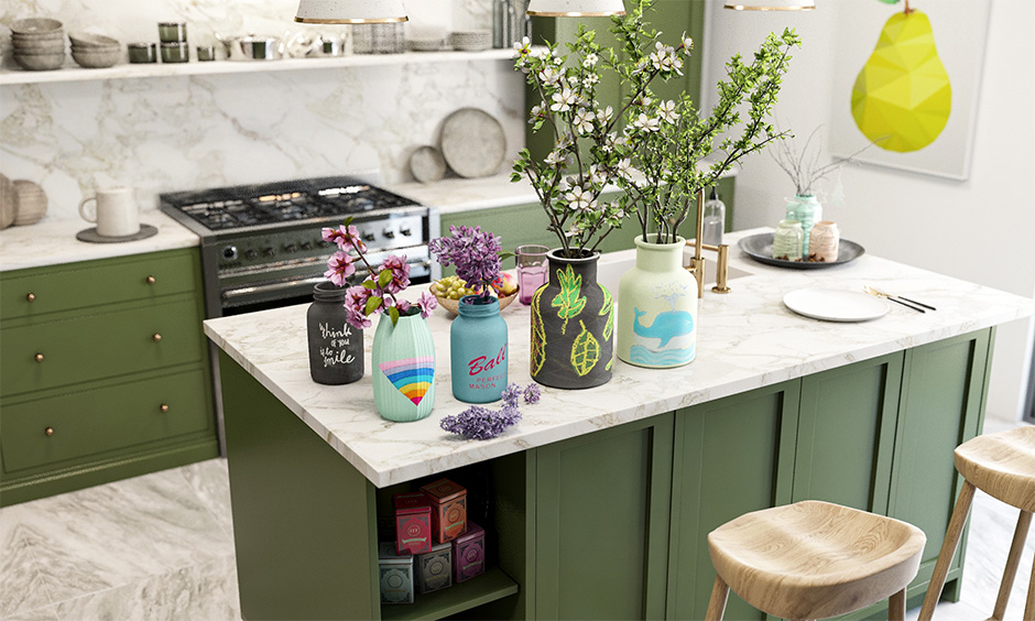 DIY jars and bottles chalk paint in Indian kitchen island in pastel colours and decorated with custom arts