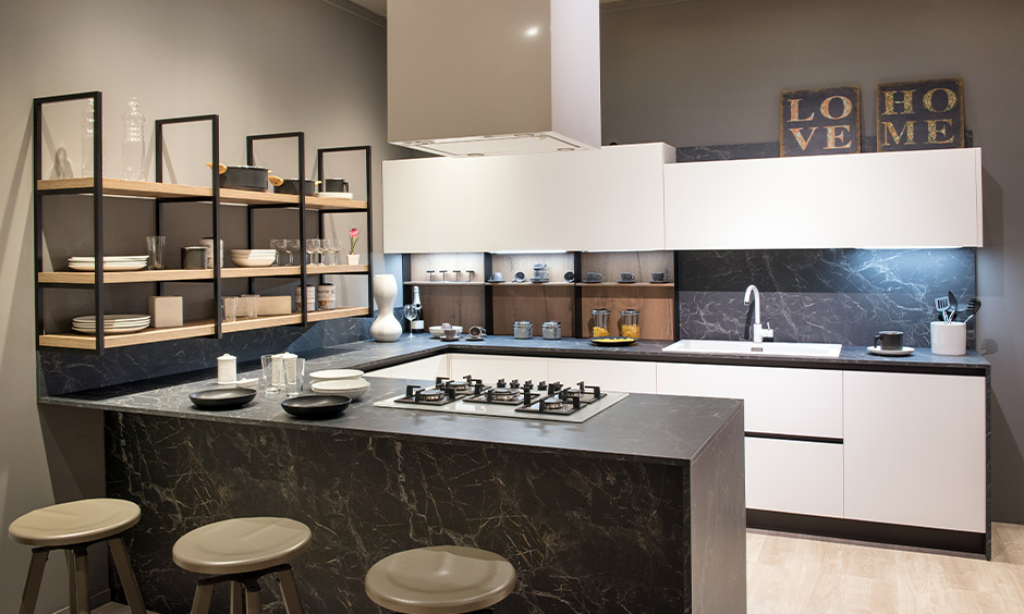 Black marble kitchen countertops with wooden shelves look elite and elegant.