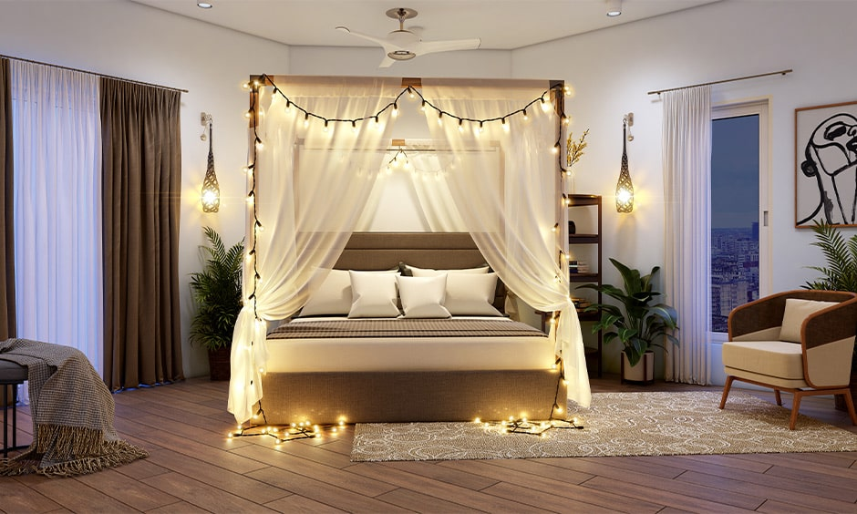 Corner bed design with a canopy in small bedroom with sheers and fairy lights