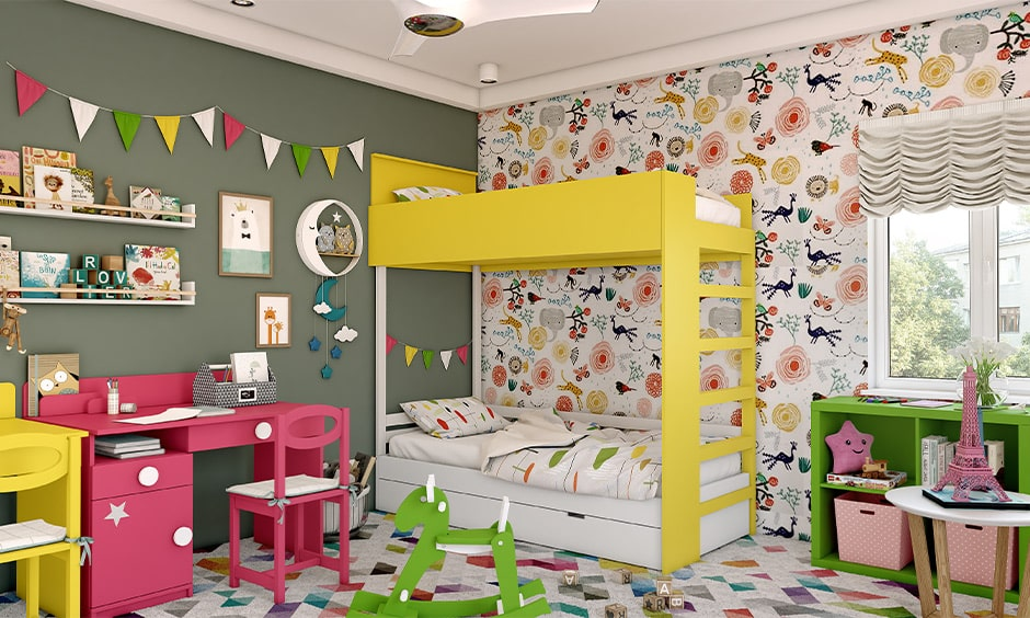 Corner bunk bed design for kids bedroom with a pink coloured study table