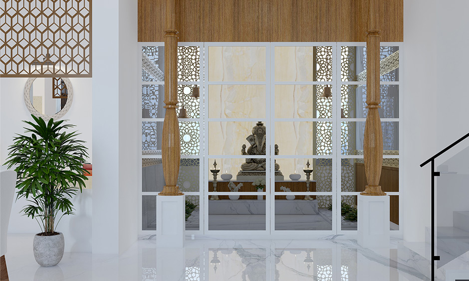 Mandir plywood design with glass door creates a magic that grows on the divine space of your pooja room.