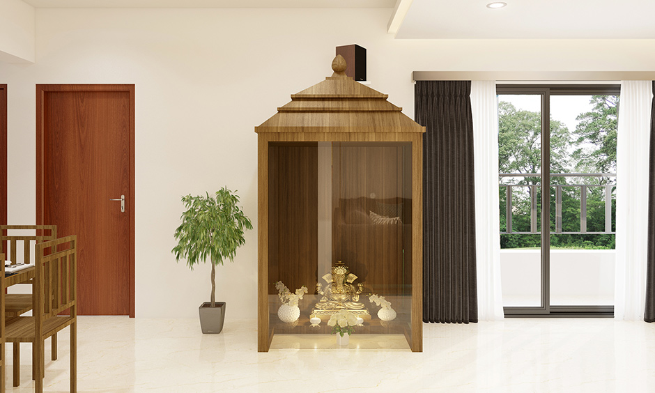 Plywood temple design for home framed with plywood and with an interplay of glass is classy.