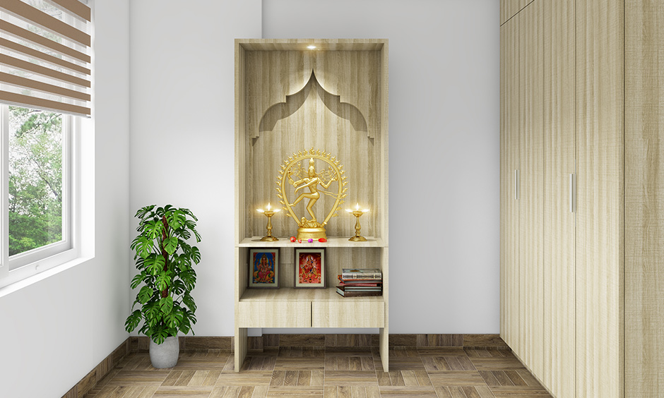 Pooja room designs in plywood simple yet traditional with integrated shelves and smartly use the space.