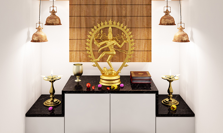 Wall-mounted plywood mandir design with the main shelf is perfect for apartments.