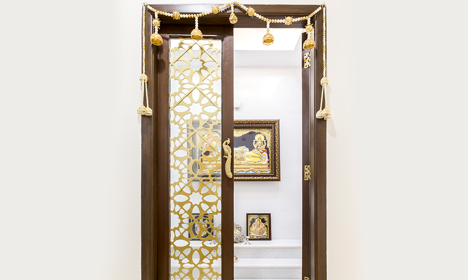 Decorative pooja door designs with glass which is inherently classy
