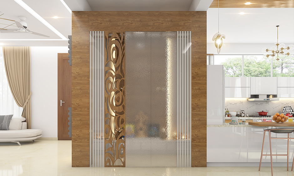 Translucent pooja room glass door designs for home which provides much needed privacy to your sacred space