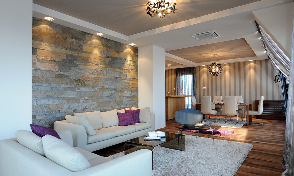 Neutral false ceiling paint design in modern living cum dining areas is light, warm and comfortable on the eyes.